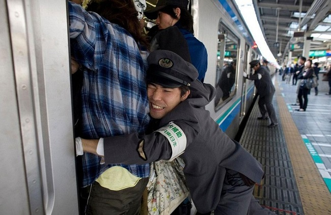 Train attendants at work in Tokyo, Japan