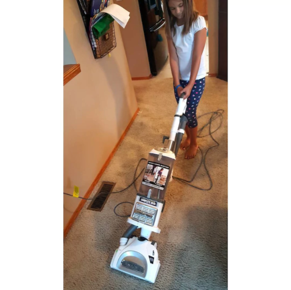 Girl cleaning home floor